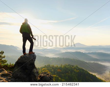 Photographer Looks Into The Landscape And Listen The Silence. Man Prepare Camera To Takes Photos