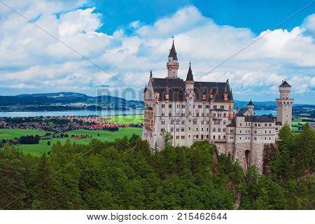 Neuschwanstein Castle Bavaria Germany Europe. Scenic view of famous fairytale german castle. Beautiful building in Bavarian Alps. Summer landscape. Popular landmark travel destination in Germany