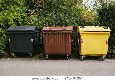 Garbage cans in a row. Separate collection of garbage and biodegradable waste.