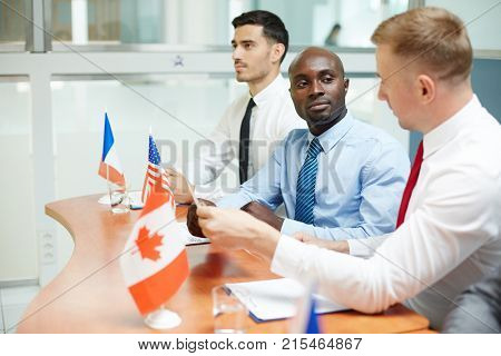 African-american politician communicating with his foreign colleague at conference of international level