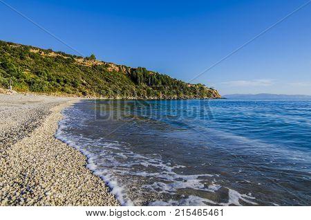 coastline and beach of Lourdata stones at sunset over the Ionian sea on the island of Kefalonia
