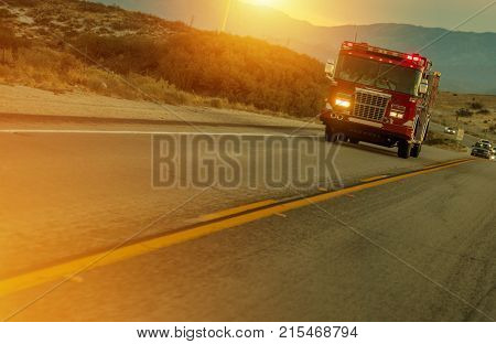 Firetruck Speeding on Highway in California USA. Fire Department Call to Action.