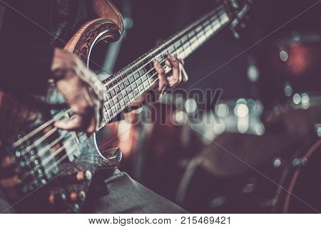 Passionate Guitarist Music Concept Photo. Electric Guitar Playing Closeup Photo