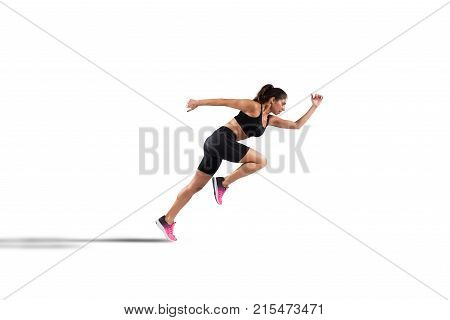 Athletic woman runner in sportswear on the asphalt of a road isolated on white background