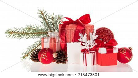 Large And Small Boxes With Gifts, Pine Branch, Cones, Toys, And Empty Card Isolated On White