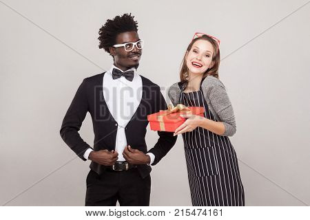 Freckled Woman Holding Gift Box, African Man Standing Near