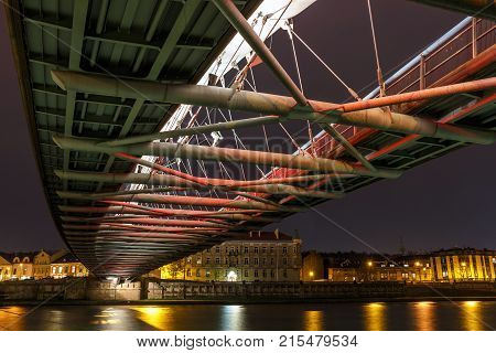 Bernatka Footbridge Over Vistula River In The Night In Krakow, Poland