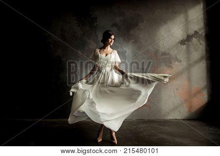 Beautiful Bride Portrait. Beautiful Bride Whirls Her Wedding Dress.