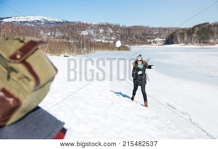 Couple Snowball Fighting And Having Fun