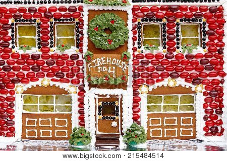 Decorated gingerbread firehouse with green and red jelly beans