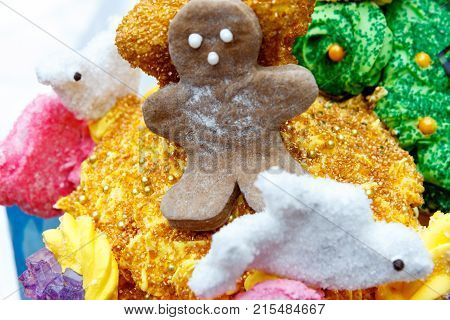 Gingerbread man sitting on decorative Christmas holiday candies