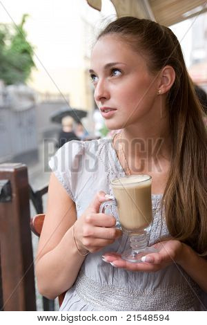 Woman Is Holding Cappuccino