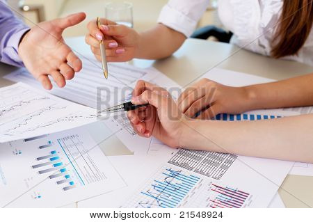 financial and business documents on the table and human hands poster