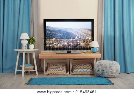 Cozy interior of living room with TV on stand