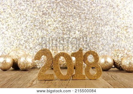 Shiny 2018 Numbers With Golden Baubles And Glittery Background, New Years Eve Concept.