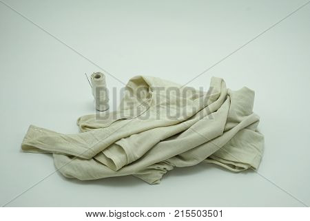 Old Tank Top Needle and thread on white background sufficiency economic concept
