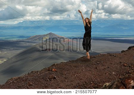 Kamchatka Peninsula, Russia - August 20, 2016: Model is posing on top of Hiking trail climb to the North Breakthrough Great Tolbachik Fissure Eruption 1975