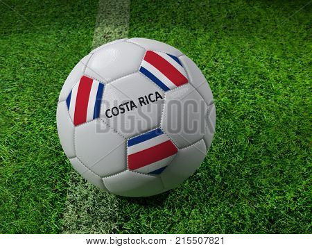 3D rendering of white soccer ball with imprinted Costa Rica as flag colors placed next to the pitch line