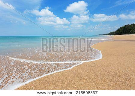 Beautiful tropical andaman seascape scenic off sandy beach phuket thailand with wave crashing on sandy shore