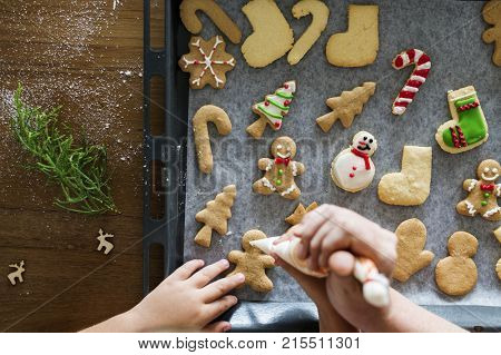Gingerbread cookies getting decorated for Christmas
