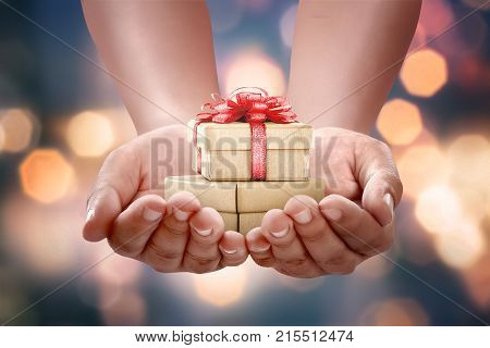 Human Hands Holding Gift Box For Boxing Day