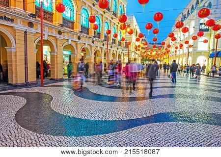MACAU - JANUARY 11, 2016 - Tourist visiting Senado Square in the evening. This square is the largest in Macau. Macau is a former Portuguese colony.