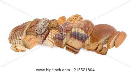 Whole and partly sliced loaves of the different types of brown bread multi grain bread with various seeds and bread with bran on a white background