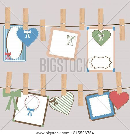 Set of cute frames and decorations hanging on a rope in cloth pegs