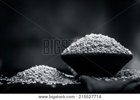 Vigna mungo, urad, Split Black gram, in a clay bowl.