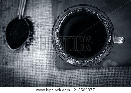 Black tea of Camellia sinensis,common tea in a transparent cup with tea powder.