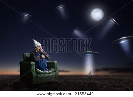 Stupid man in tinfoil helmet at night, UFO phobia