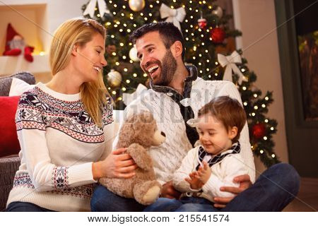 Beautiful cheerful young family have fun on Christmas