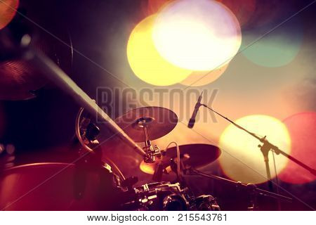 Live music. Concert and band on stage. Festival and show background. Musical background.Drumkit on stage lights performance