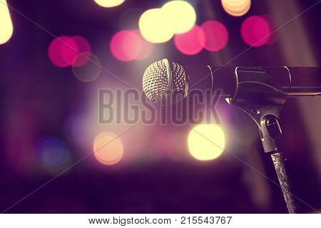 Live music background. Microphone and stage lights. Microphone and stage lights.Concert and music concept