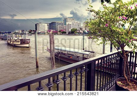 Bangkok city landmark. Skycraper and river Chao phraya.Typical tourist boat