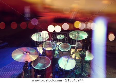 Live music.Concert and band on stage.Festival and show background.Musical background.Drumkit on stage lights performance
