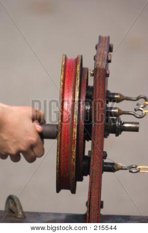 Child Making Rope With Machine