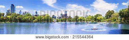 Scenic landscape park and skyscraper. Lake and trees.Scenery cityscape Bangkok Lumphini park