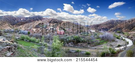 Village moroco and draa river over the Atlas mountain.Desert travel and adventures.
