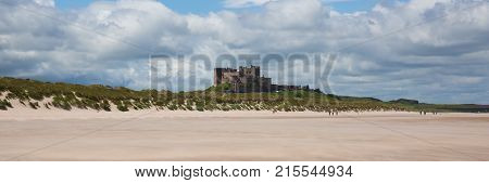 Bamburgh Castle Northumberland north east England UK with white sandy beach panoramic view