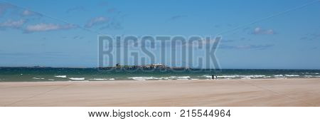 Northumberland beach and coast at Bamburgh north east England UK with panoramic view to the Farne islands