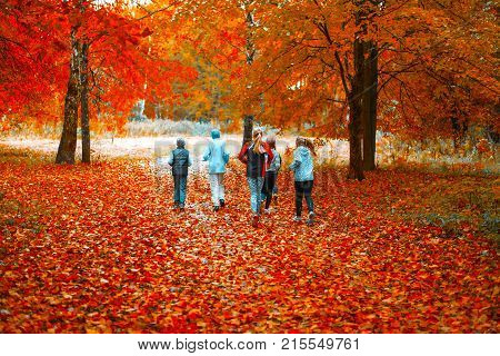 Little children run group charge bright orange park fall. Running athletes park run early morning. Several children running woods doing sports. Healthy lifestyle.