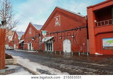Hakodate Hokkaido-14 February 2017: Hakodate Kanemori Red Brick Warehouses the first commercial warehouse Hakodate Japan cityscape at the historic Red Brick Warehouses and Mt. Hakodate.