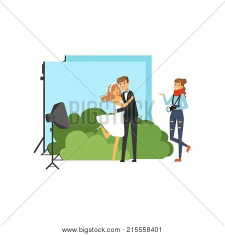 Romantic pre wedding photo shoot in studio with colorful decorations. Lovers couple. Young girl photographer with camera in hand. Blue backdrop, green bushes, soft box. Flat vector people characters