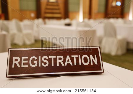 Wooden signs of registration on a table for welcoming attendees or seminar.