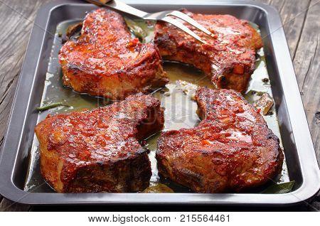 Tasty Pork Chops On Baking Sheet