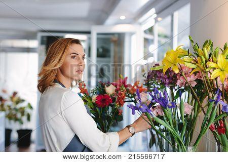 Woman Working In Retail Flower Shop