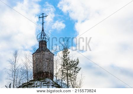 Dilapidated dome of old Orthodox Church against the cloudy sky.