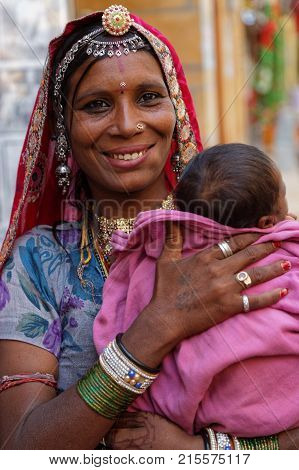 Jaisalmer, India, November 2, 2017 : Portrait Of A Young Gypsy Woman With Her Baby In Her Arms. Gyps