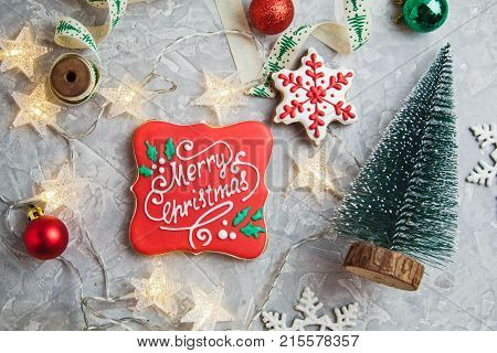 Beautiful Christmas Background With A New Year Décor, A Sheet Of Old Paper, Garland And Gifts On A W